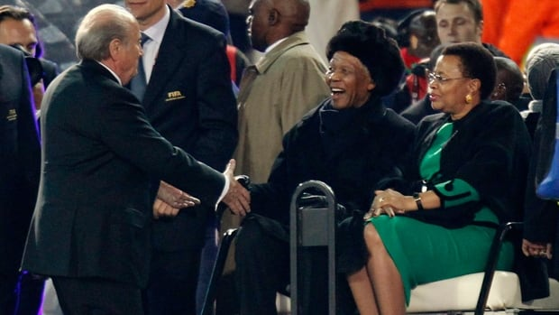 In this file photo, FIFA president Sepp Blatter, left, shakes hands with former South African President Nelson Mandela, centre, during one of Mandela's last major public appearances at the closing ceremony of the 2010 South Africa World Cup.