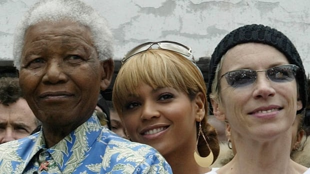 Former South African president Nelson Mandela appears with singers Beyonce Knowles, centre, and Annie Lennox on Robben Island in Cape Town in 2003 for the Nelson Mandela 46664 AIDS Awareness concert.