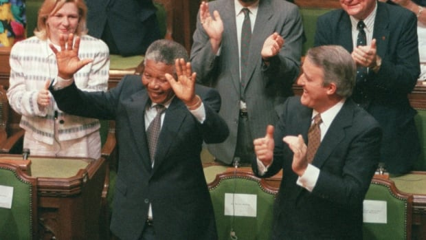 South African anti-apartheid activist Nelson Mandela  is acknowledged by then Prime Minister Brian Mulroney and other members of Parliament in Ottawa, June 18, 1990.