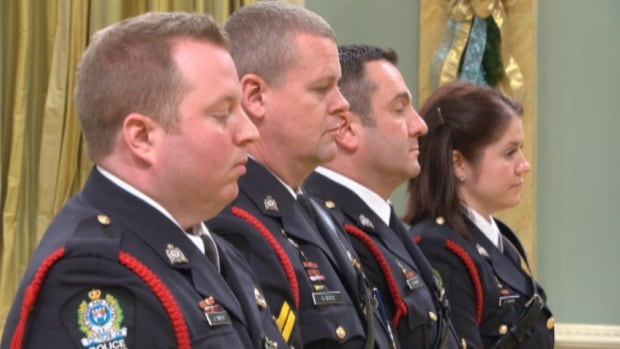 Const. Jeffrey Smiley, pictured here in the foreground during an awards ceremony at Rideau Hall in December, is scheduled to enter pleas on March 18.