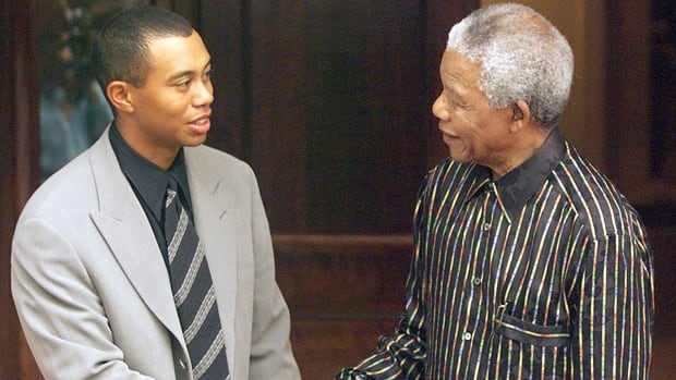 Golf superstar Tiger Woods, left, is introduced to Nelson Mandela at the latter's Johannesburg residence on Nov. 30, 1998.