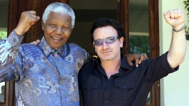 Nelson Mandela, seen in 2002 at his residence at Houghton in Johannesburg with U2 singer Bono, long served a cause and inspiration to the entertainment community.
