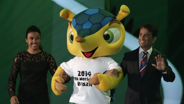 Marta and former Brazilian soccer player Bebeto introduce the World Cup mascot Fuleco during the draw for the 2014 World Cup, which will open with host Brazil playing Croatia.