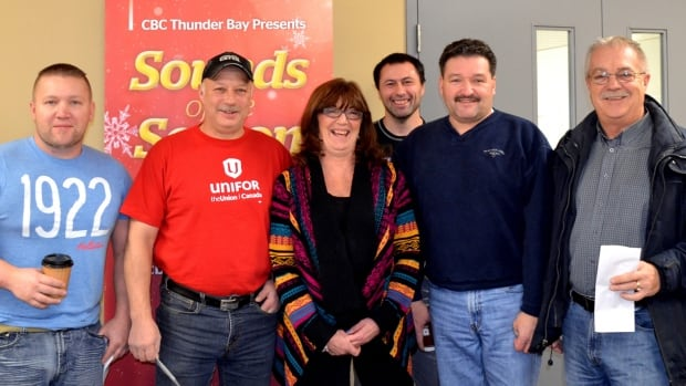 Representatives of several Unifor locals presented cheques to the Regional Food Distribution Association during CBC Radio's Sounds of the Season live broadcast. CBC's Lisa Laco (centre) hosted the program.