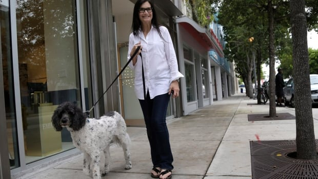 A dog heads out for a stroll.