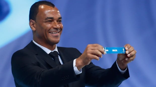 Brazilian former soccer great and World Cup winner Cafu holds the ticket of Brazil during the draw ceremony for the 2014 World Cup in Costa do Sauipe near Salvador, Brazil, on Friday.