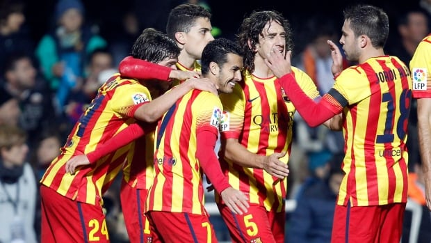 Barcelona's Pedro Rodriguez, centre, is congratulated by teammates after scoring a goal against Cartagena during their la copa del Rey soccer match Friday at the Cartagonova stadium in Cartagena, Spain.