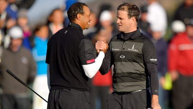 Tiger Woods, left, and Zach Johnson shake hands after finishing on the 18th hole during the third round of the World Challenge at Sherwood Country Club on Saturday in Thousand Oaks, Calif.