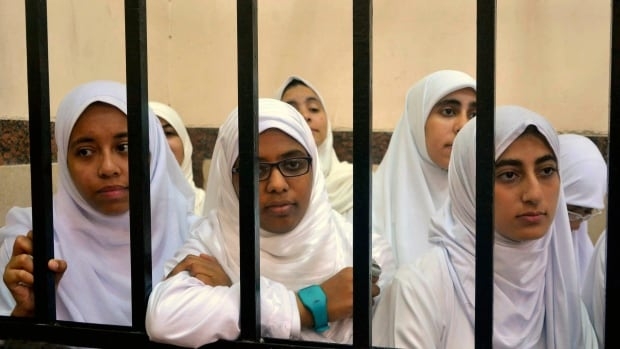 The 14 women, mostly around the age of 20, were originally sentenced to 11 years in prison. Defence lawyer al-Shimaa Saad said they received one-year suspended sentences while the seven teenagers' sentences were reduced to three-month probation.