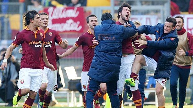 Roma's Mattia Destro, centre, celebrates with teammates after scoring against Fiorentina at Stadio Olimpico on December 8, 2013 in Rome, Italy.
