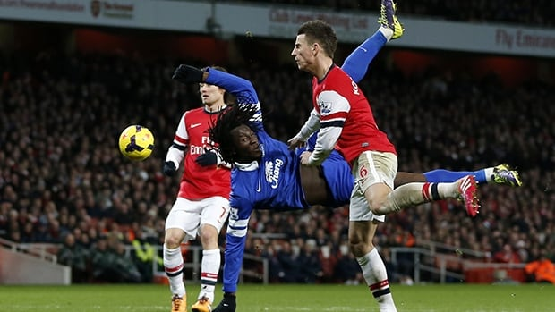 Arsenal's Laurent Koscielny, right, vies for the ball with Everton's Romelu Lukaku at The Emirates Stadium in north London on December 8, 2013.