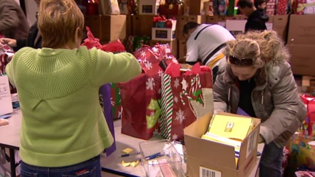 Volunteers packed hundreds of gifts for isolated Calgary seniors.