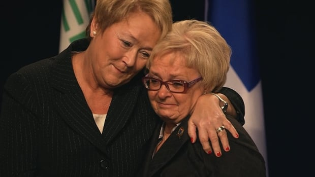 Quebec Premier Pauline Marois and Lac-Mégantic Mayor Colette Roy-Laroche broke down in tears Sunday at a ceremony honouring the bravery of people who tended to the small southern Quebec town during the July 6 train disaster.