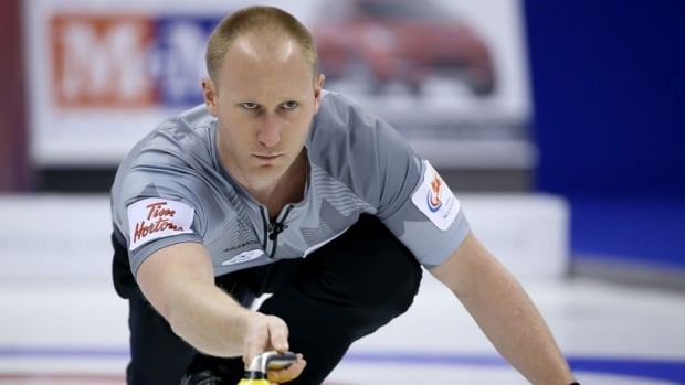 Skip Brad Jacobs throws a rock in the Men's Final against Team Morris at the Roar of the Rings Canadian Olympic Curling Trials on Dec. 8, at the MTS Centre in Winnipeg, Man.