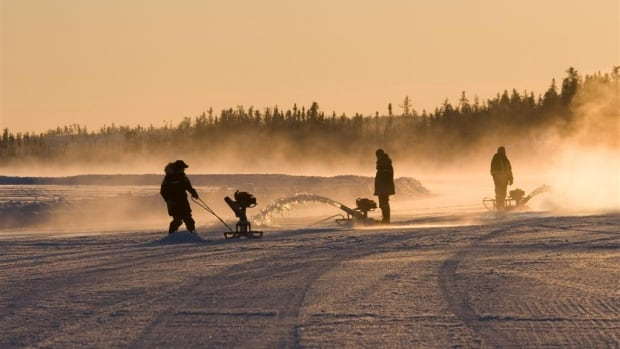 Workers flood the ice on the Tibbitt to Contwoyto winter road in the Northwest Territories in this file photo.