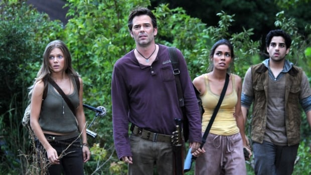 Revolution cast members (from left) Tracy Spiridakos, Billy Burke, Daniella Alonso and Paras Patel appear in a scene from the NBC series. According to a study, violent scenes on broadcast networks carry milder parental cautions than similar footage on cable.