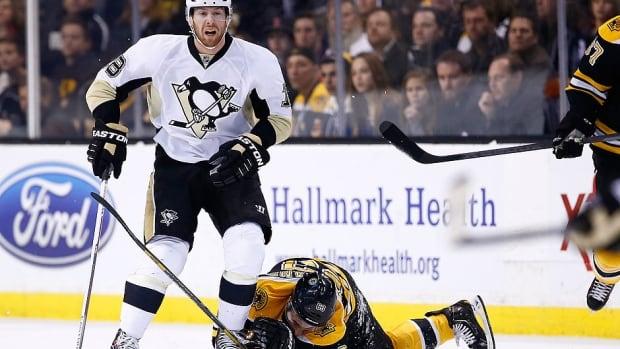 Bruins forward Brad Marchand, right, is kneed in the head by the Penguins' James Neal, left, in the first period of Saturday's game in Boston. Neal was penalized on the play and further punished by the NHL Monday with a five-game suspension.