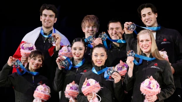 Canadian figure skating team members who won silver in April were, front row from left: Meagan Duhamel, Kaetlyn Osmond, Gabrielle Daleman, Kaitlyn Weaver, rear row from left, Eric Radford, Kevin Reynolds, Patrick Chan, and Andrew Poje.