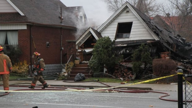 Blown-out glass from the window can be seen on the road after an explosion at this Wilson and Victoria streets home.