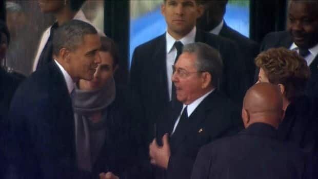 Obama shakes Castro's hand