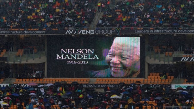"""Tens of thousands filed into a 95-thousand seat capacity soccer stadium in a Johannesburg Tuesday to remember former South African president Nelson Mandela, a man eulogized by US president Barack Obama as """"the 20th century's last great liberator."""""""