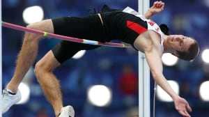 Canadian high jumper Derek Drouin, seen here competing at the world track and field championships in Moscow in August, is the recipient of three Athletics Canada awards as outstanding athlete of the year, athlete of the year in field events, and outstanding performance of the year.
