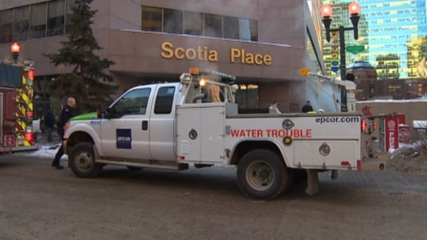 An EPCOR truck sits in front of Scotia Place on Tuesday. A water main break forced the evacuation of the downtown office towers on Wednesday.