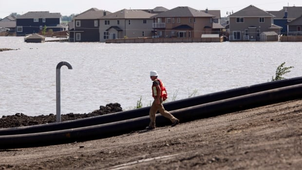 In the early stages of the flooding in High River, officials decided to build two berms to help control the water but it ended up sitting in the area for weeks.