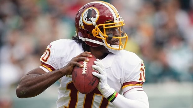 Redskins head coach Mike Shanahan, who has elected to start Kirk Cousins on Sunday at Atlanta ahead of Rex Grossman and Robert Griffin III, pictured here, said on Monday he was considering benching Griffin for the rest of the season to keep the quarterback healthy for the off-season.