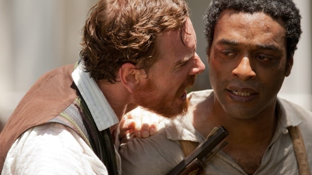 Michael Fassbender, left, and Chiwetel Ejiofor appear in a scene from the searing drama 12 Years A Slave, which will be distributed to U.S. public schools beginning this September.