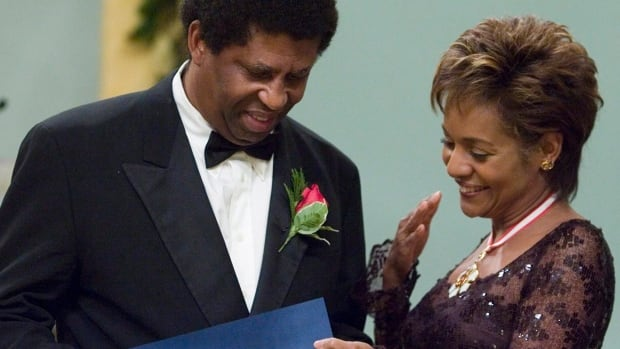 Writer Dany Laferrière, seen receiving the Governor General's Literary Award from former governor general Michaëlle Jean in 2006, has become the first Quebec writer and the first Haitian to be elected to the prestigious Académie française.