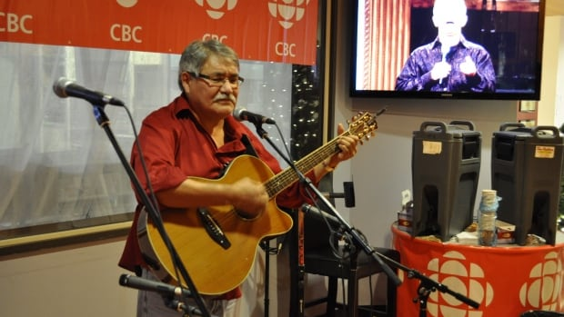 Former CBC host Paul Andrew plays to the audience in the foyer of CBC Yellowknife during the 2012 open house.