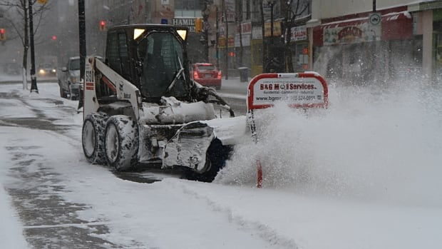 Crews began to clear roads and sidewalks in downtown Hamilton on Saturday morning as the first big snowstorm of the season hit the city.