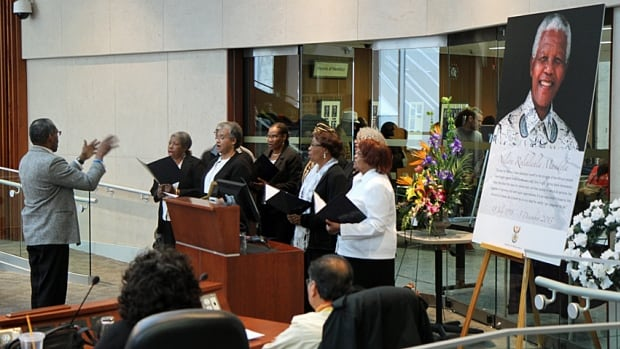 Members of Stewart Memorial Church's Guava Tree Choir perform a hymn at a memorial for Nelson Mandela at Hamilton's city hall on Saturday.
