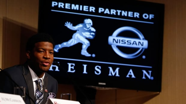 Jameis Winston, quarterback of the Florida State Seminoles, speaks to the media during a press conference prior to the 2013 Heisman Trophy Presentation on Saturday in New York City.