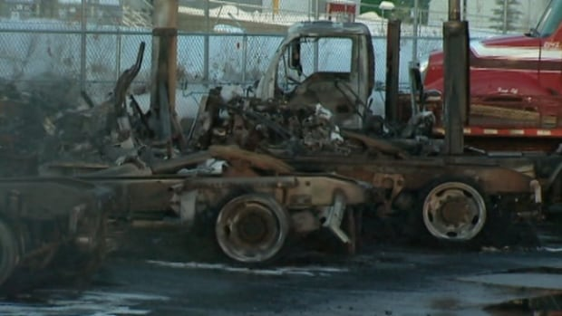 Fire officials are looking into the cause of a blaze that destroyed five trucks in south Edmonton early Sunday morning.