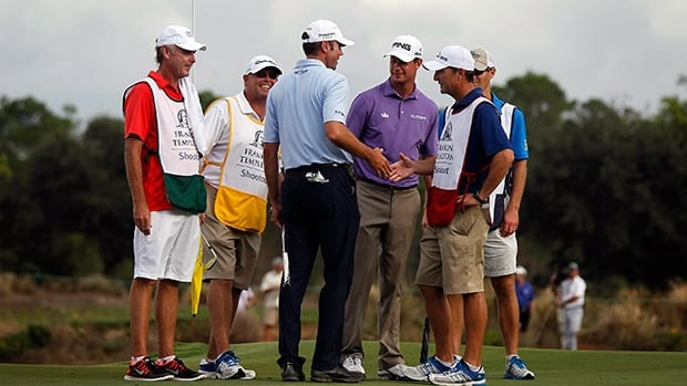 Matt Kuchar, centre, and Harris English, centre right, celebrate after the second round Saturday, Dec. 14, 2013, at Tiburon Golf Club in Naples, Fla.