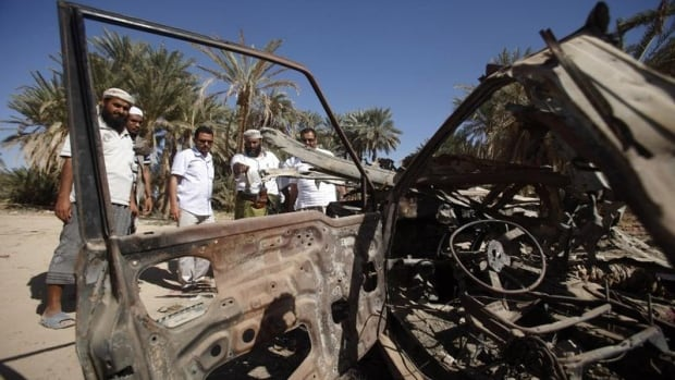 People gathered around the site of the debris left by a U.S. drone strike that targeted suspected al-Qaeda militants in August 2012, in the southeastern Yemeni province of Hadhramout. Yemeni parliament passed a non-binding motion on Sunday to stop drone strikes, reflecting growing public anxiety about Washington's use of unmanned aircrafts to combat al-Qaeda in the impoverished country.