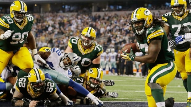 Green Bay Packers running back Eddie Lacy (27) scores a touchdown against the Dallas Cowboys during the second half on Sunday in Arlington, Texas.