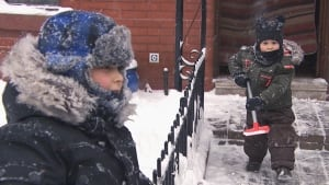 Kids clearing snow