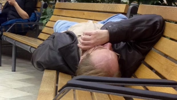 People try to catch some sleep after a slew of flights cancelled
