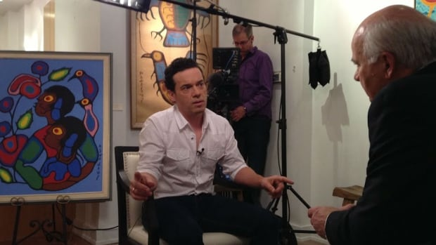 Joseph Boyden, left, talks with Peter Mansbridge in exclusive interview at the Maslak McLeod Gallery.