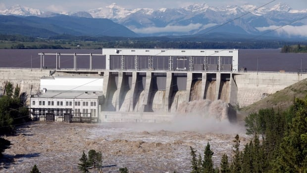 The Bow River pours through the dam on Ghost Lake near Cochrane on June 22. The City of Calgary is hoping for some changes around the operation of the dam during flood events.