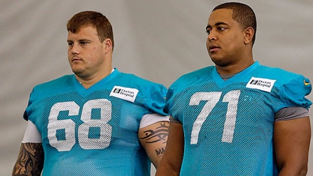 Richie Incognito, left, has reportedly been suspended for the rest of season for allegedly harassing Miami Dolphins teammate Jonathan Martin, right.