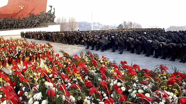 North Korean officials offer flowers at Mansudae in Pyongyang on the eve of the second anniversary of the death of former leader Kim Jong-il on Monday. At the same time, the (North) Korea Central News Agency deleted some 35,000 online articles from its archives, keeping records that only go back to October 2013.