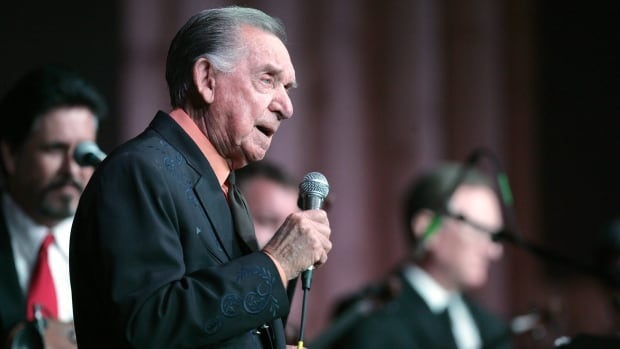 Country Music Hall of Fame member and Grammy award winner Ray 'The Cherokee Cowboy' Price, pictured here performing in January 2011, has died at the age of 87.