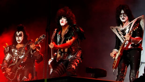 Members of the band KISS, from left, Gene Simmons, Paul Stanley and Tommy Thayer, perform in Mexico City in 2012. The flamboyant group will finally be inducted into the Rock and Roll Hall of Fame after repeat nominations.