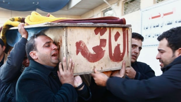 Mourners carry the coffin of their relative, who was killed in an attack in the town of Yusfiya, during a funeral in Najaf, 160 km south of Baghdad on Tuesday. The attack took place in Yusfiya, 20 km south of Baghdad, the latest in a series of attacks mostly targeting Shias, who mark a religious festival next week.