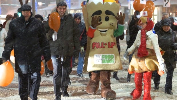 Edmonton Mayor Don Iveson joins CBC's Turkey Drive Parade on the opening day of the week-long event which hopes to raise $500,000 in turkeys and cash for Edmonton's food bank.