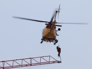 A helicopter from CFB Trenton was called in to rescue a crane operator stranded high above a construction site fire in downtown Kingston, Ont., on Dec. 17.